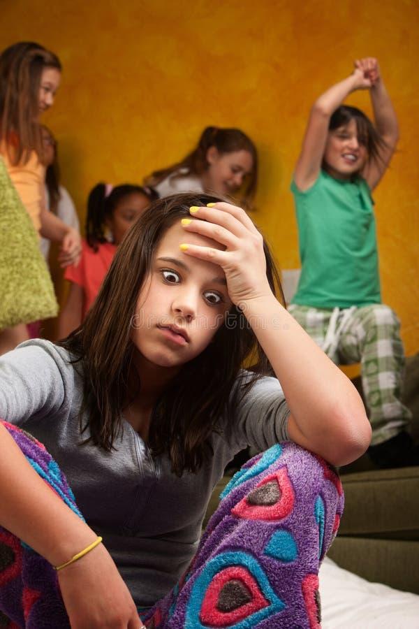 Overwhelmed babysitter. Overwhelmed and tired teen girl babysitting wild kids stock images