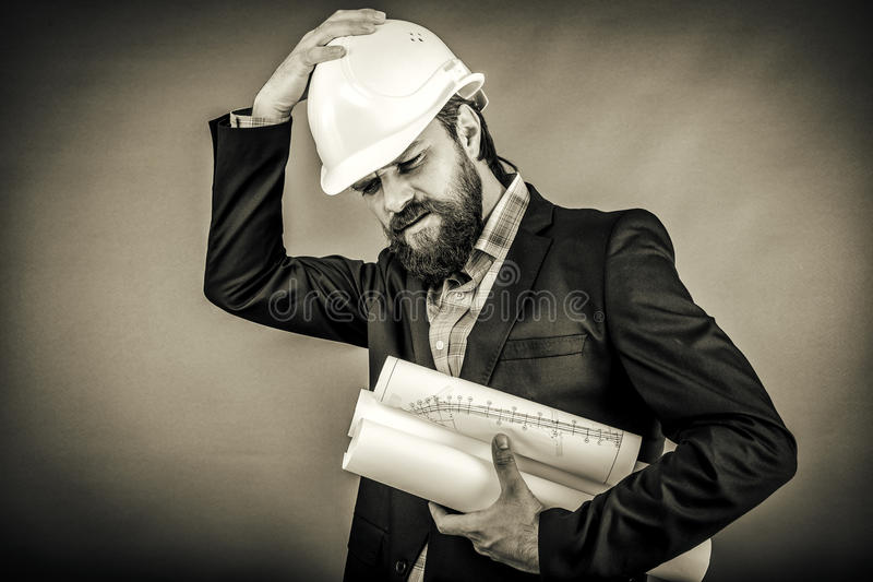 Overwhelmed businessman with hardhat royalty free stock photos