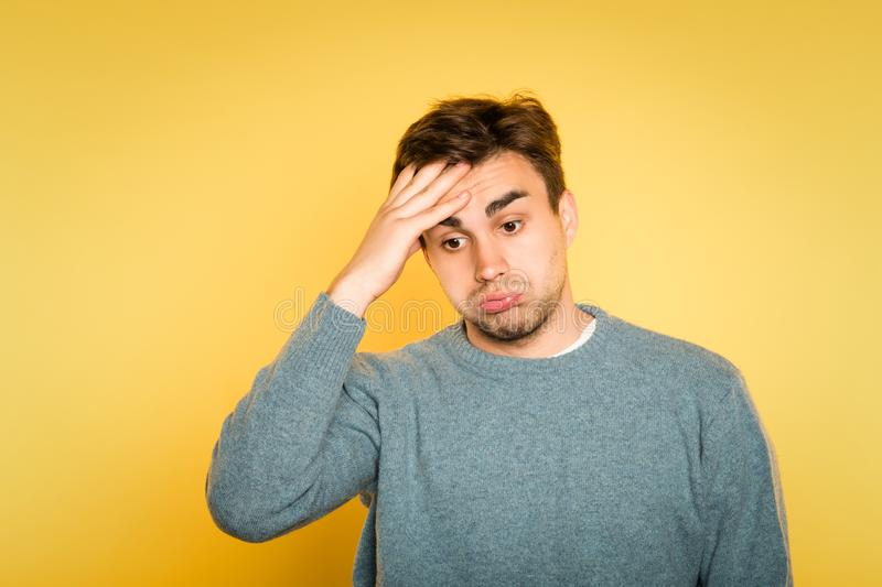 Overwhelmed dizzy confused man hold head emotion royalty free stock images