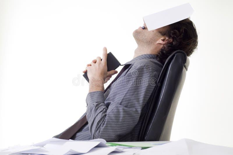 overworked бизнесмен стоковая фотография