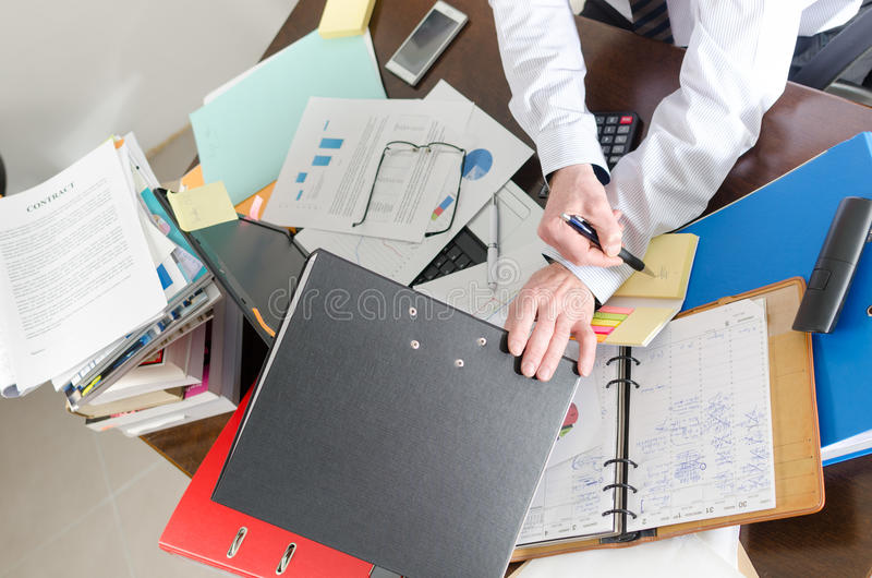 Overworked businessman royalty free stock photography
