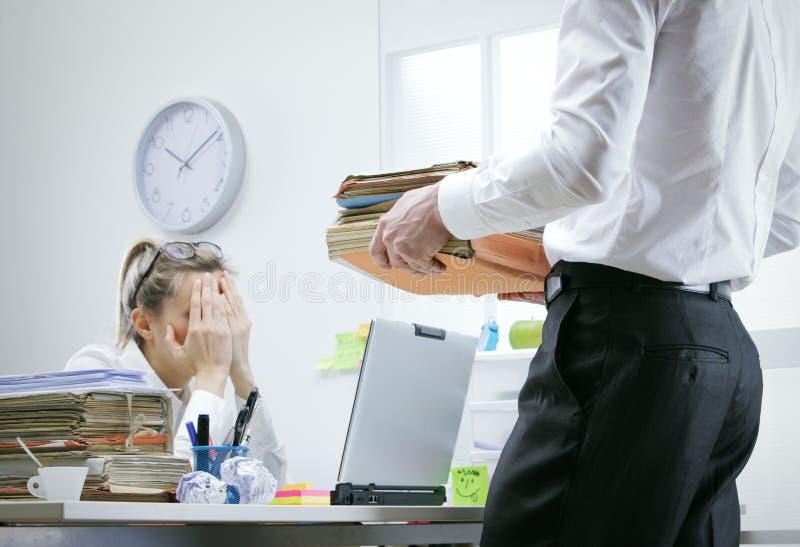 Overworked businesswoman stock photo