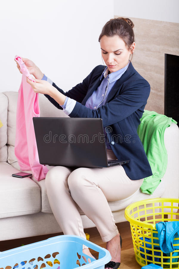 Overworked businesswoman at home. Vertical view of a overworked young businesswoman at home royalty free stock photography