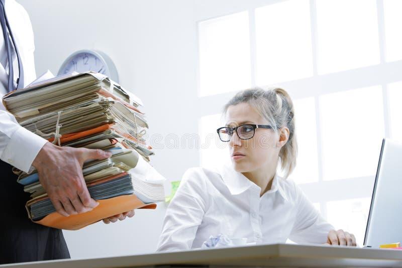 Overworked businesswoman stock image