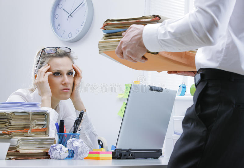 Overworked businesswoman royalty free stock photo