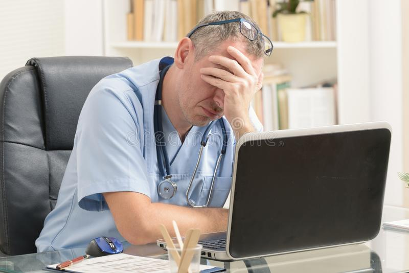 Overworked doctor in his office stock photos