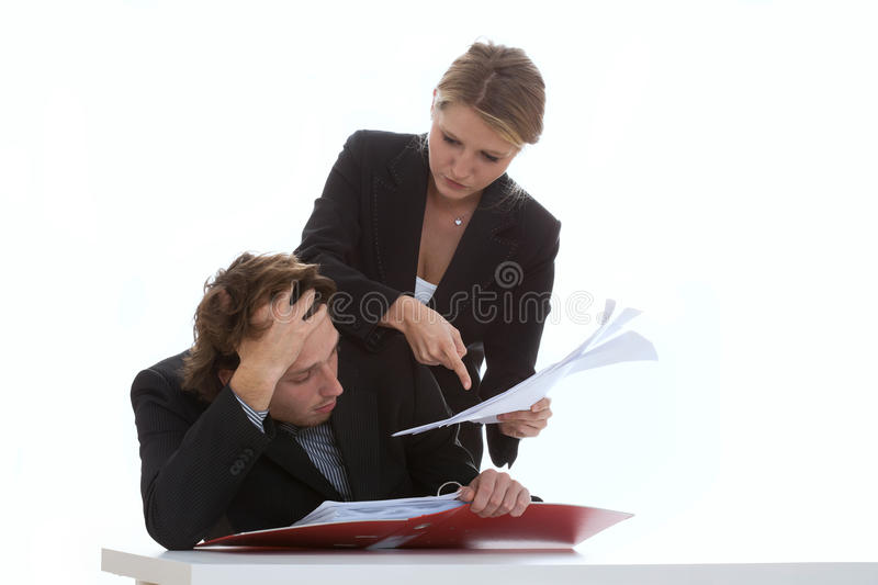 Overworked Employee And Exigent Leader Stock Photo
