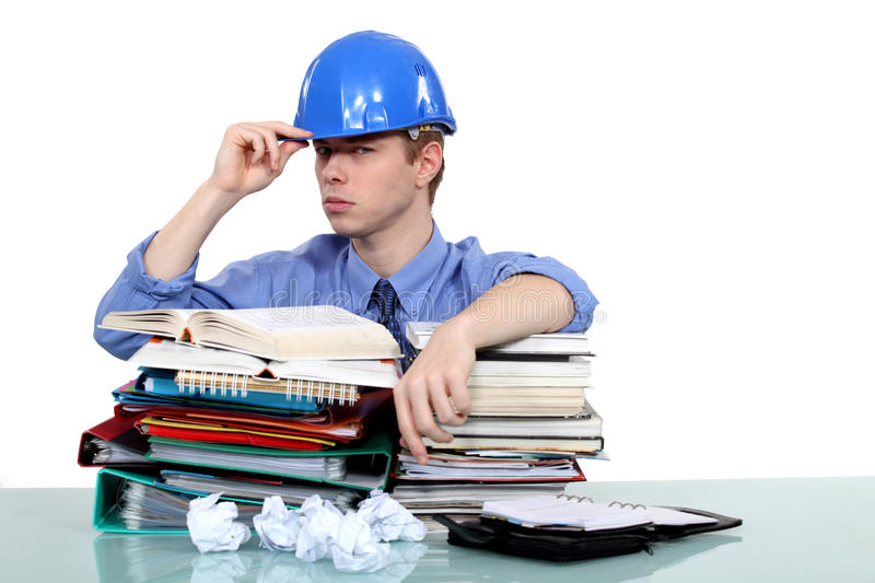 Overworked engineer. Struggling with heavy workload stock photography