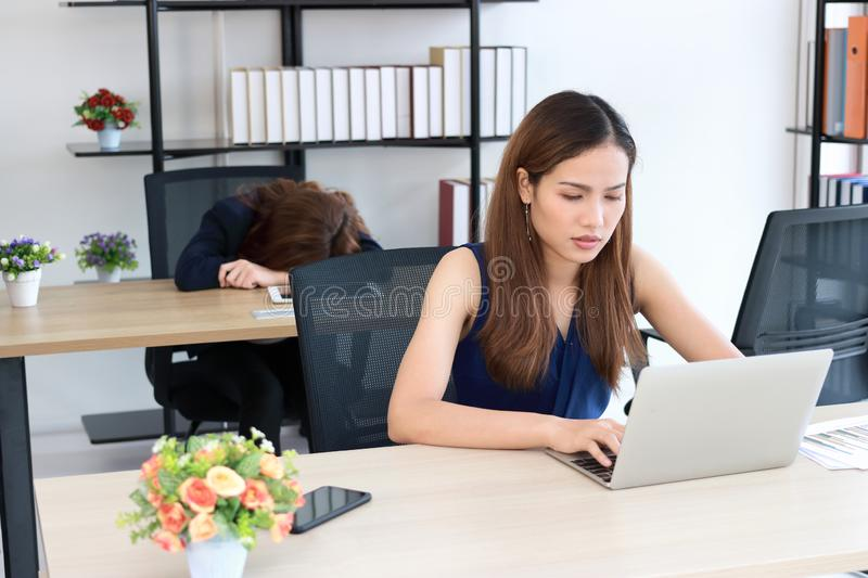Overworked frustrated young Asian business woman feeling tired on workplace in office royalty free stock photos