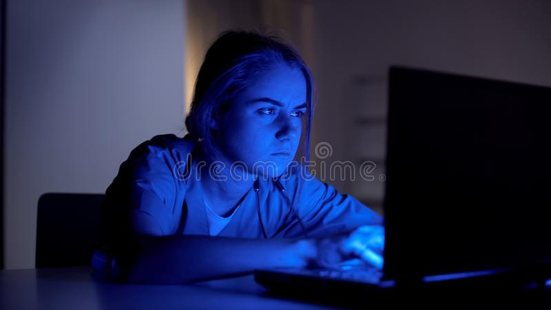 Overworked intern working on project during night shifts in hospital, education stock photos