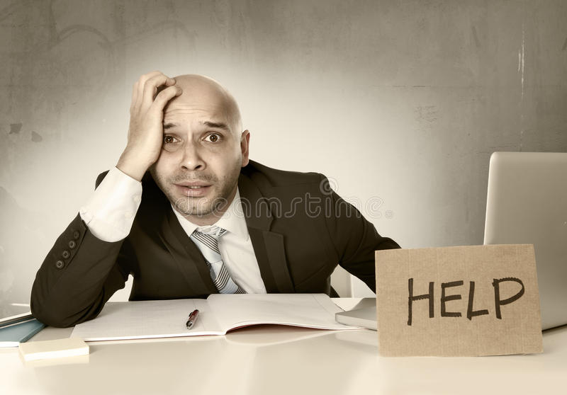 Overworked unhappy bald Hispanic businessman in stress with computer stock images