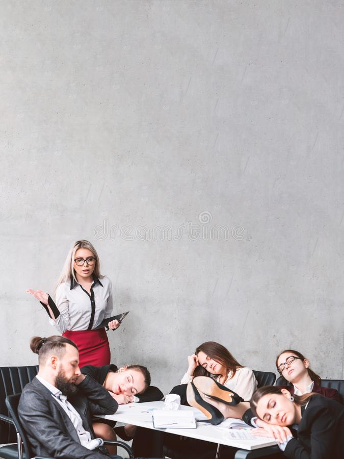Overworking business workload tired exhausted team. Overworking and business workload. Astounded teamlead looking at colleagues sleeping at workplace. Tired royalty free stock photo