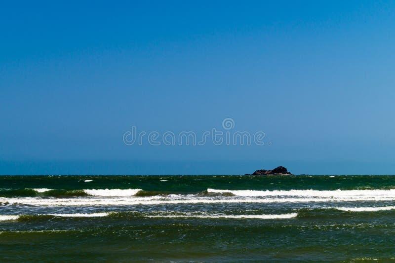 Overzees en eiland stock afbeeldingen