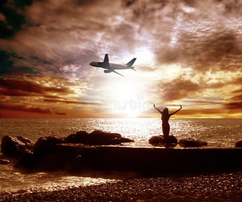 Overzees en vliegtuig stock afbeelding