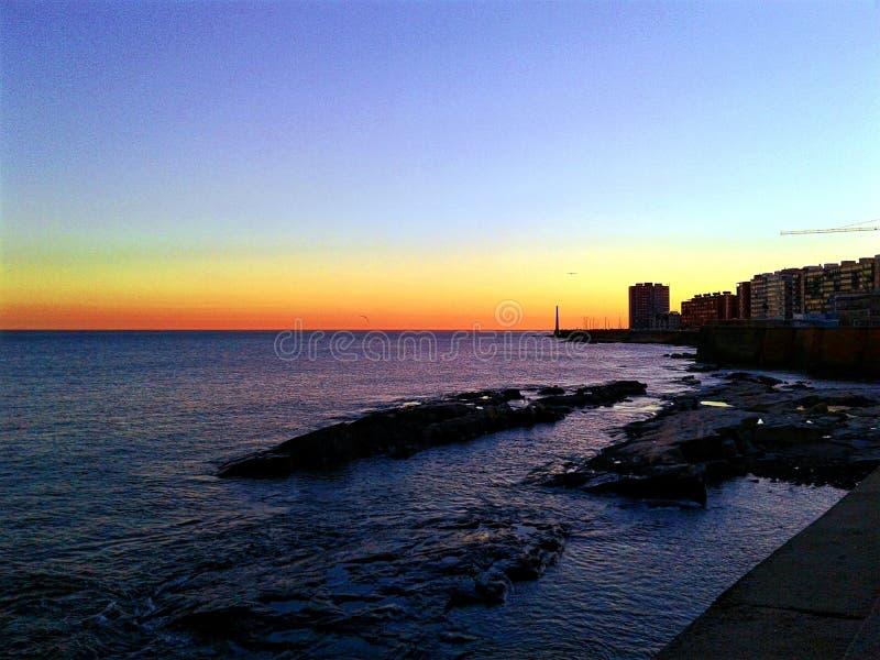 Overzees en zonsondergang stock fotografie