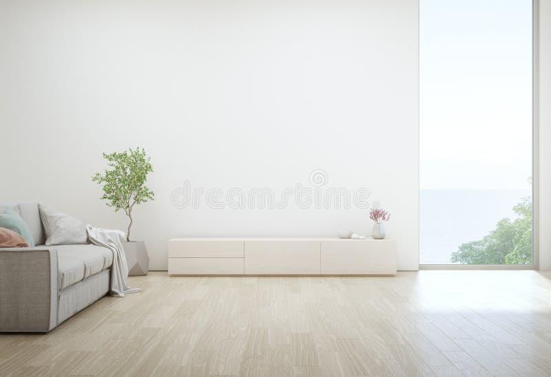 Overzeese meningswoonkamer van het strandhuis van de luxezomer met TV-tribune en houten kabinet royalty-vrije stock afbeelding