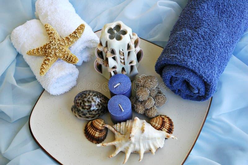 Overzeese shells en handdoeken stock afbeeldingen