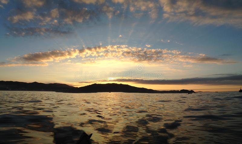 Overzeese zonsondergangvlek stock foto's