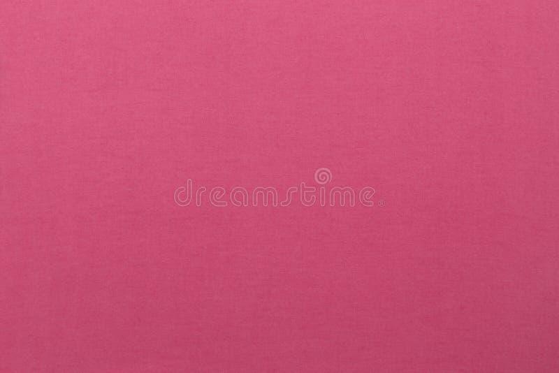 Overzicht van roze katoenen stof met textieltextuurachtergrond royalty-vrije stock afbeelding