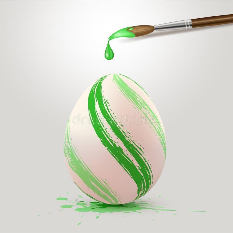 Ovo da páscoa e pincel verdes ilustração do vetor