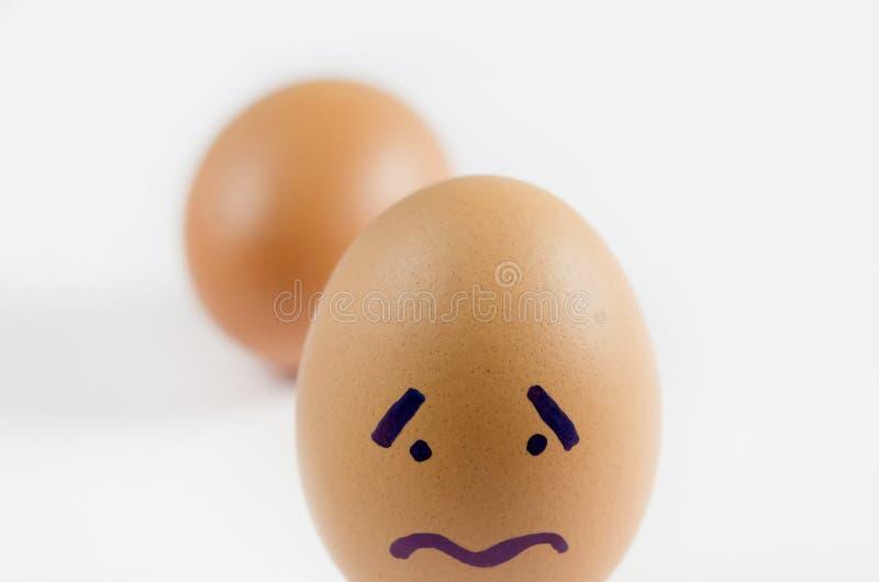 Ovos com face triste imagens de stock royalty free