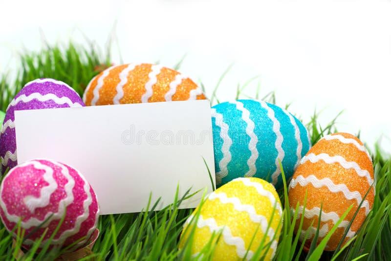 Ovos de Easter e nota em branco imagens de stock royalty free