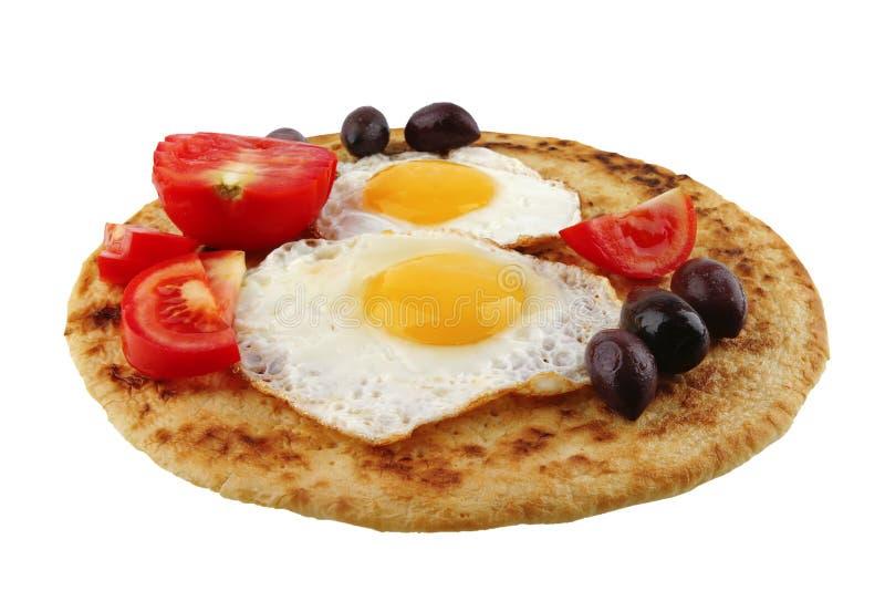 Ovos fritados na panqueca fotografia de stock royalty free