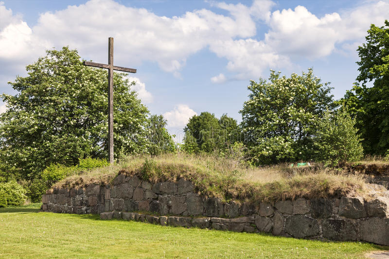 Ovraby church ruin Halmstad Sweden. Image of large wooden cross by Ovraby church ruin outside Halmstad, Sweden stock images