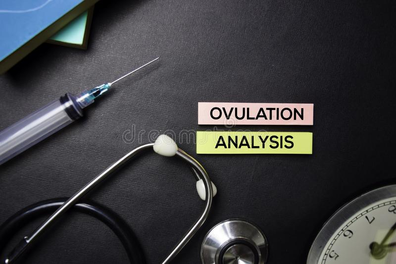 Ovulation Analysis text on Sticky Notes. Top view isolated on black background. Healthcare/Medical concept royalty free stock photos