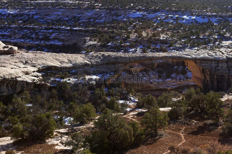 Owachomo Bridge, Natural Bridges National Monument. Owachomo Bridge seen from above on a sunny winter afternoon royalty free stock images