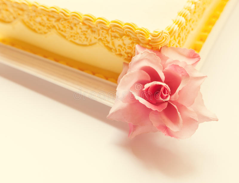 Owl Birthday Cake. Yellow birthday cake with pink owl of sugar on the top royalty free stock photography