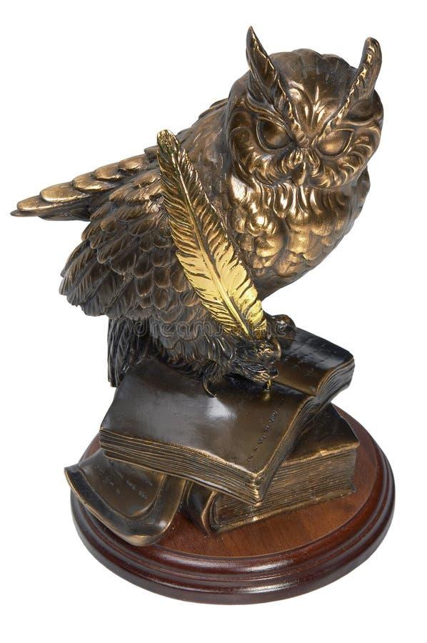 Owl bronze figurine. Nice owl bronze figurine on wooden base royalty free stock image