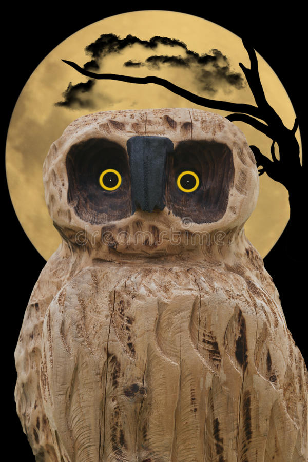 Owl. Carved wooden owl with beady eyes and spooky background royalty free stock images