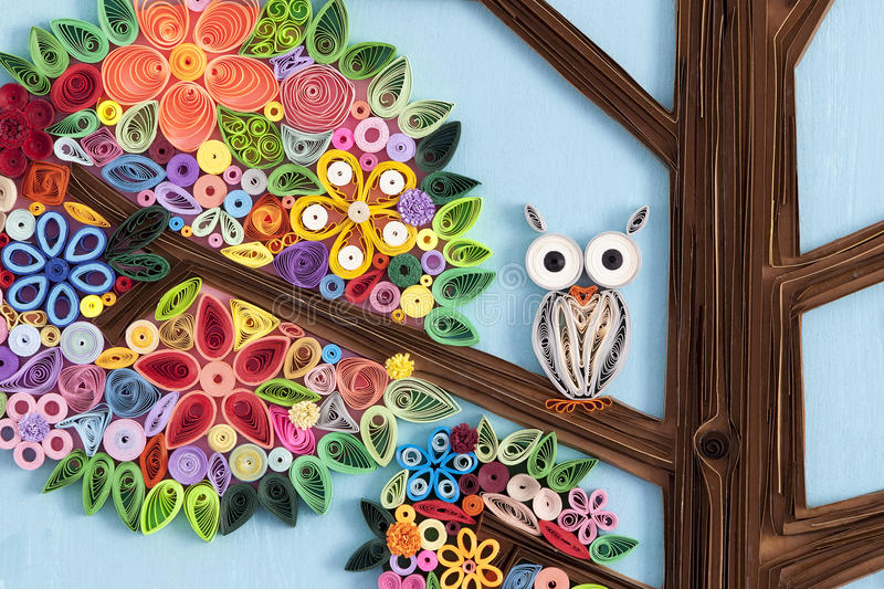 Owl in a quilling art tree royalty free stock photos