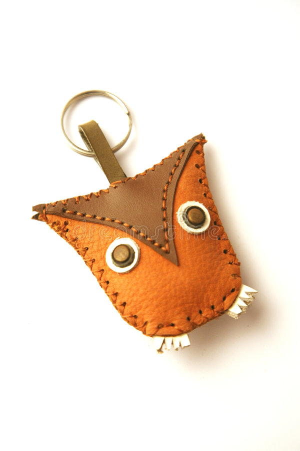 Owl shaped keychain. Brown leather owl shaped keychain royalty free stock image