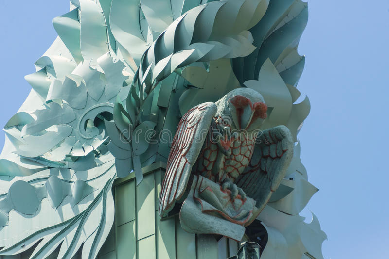 An owl statue on a building roof stock photography