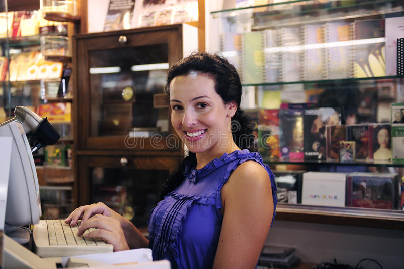 Owner of a bookstore. Owner of a small business/ bookstore royalty free stock photo