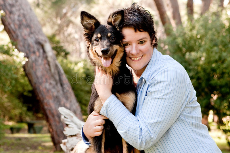 Owner and dog. Young lady holding her mix breed dog royalty free stock photo