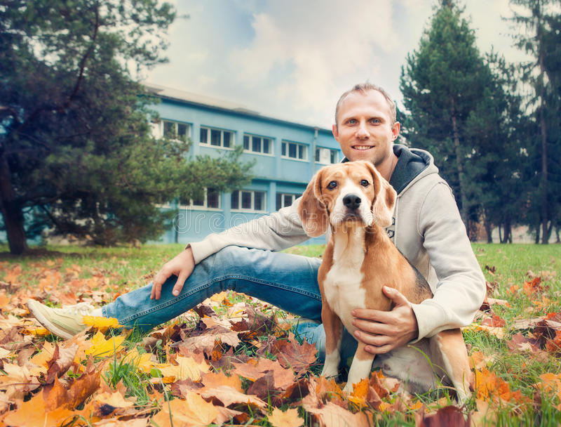 Owner with his dog on the autumn walk in park stock photos