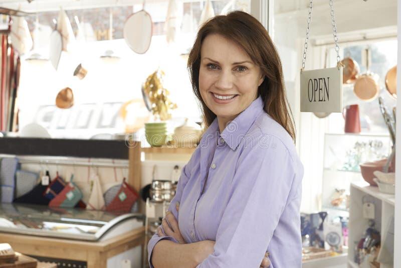 Owner Of Homeware Shop Standing In Doorway royalty free stock photos