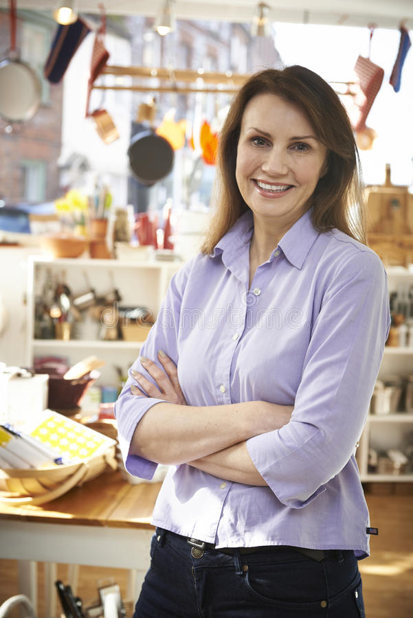 Owner Of Homeware Shop Standing In Store royalty free stock photo