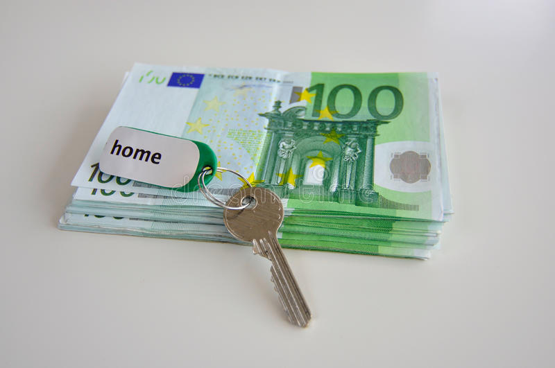 Owning a home costs money royalty free stock photo