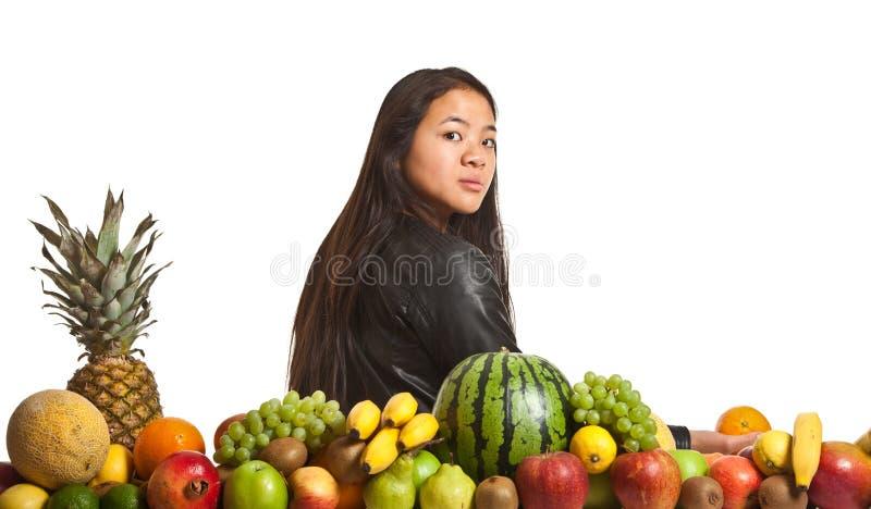 Owoc i dziewczyna zdjęcia royalty free