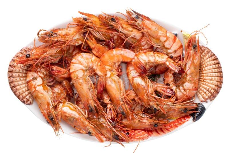 Owoce morza tło Zbliżenie świeży piec na grillu duży krewetka tygrys, garnele na kolorowym owoce morza talerzu odizolowywającym n obrazy stock