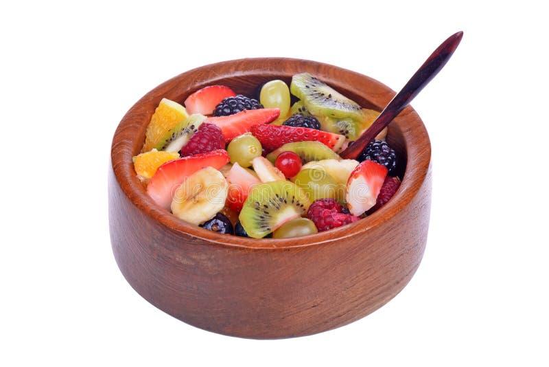 Owocowa sałatka z truskawkami, pomarańcze, kiwi, czarne jagody fotografia stock