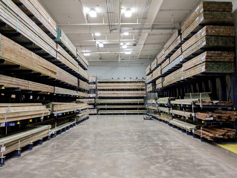 Ows of Wood Lumber For Sale Inside Lowe& x27;s Home Improvement store. Honolulu - June 18, 2018: Rows of Wood Lumber For Sale Inside Lowe& x27;s Home Improvement stock photo