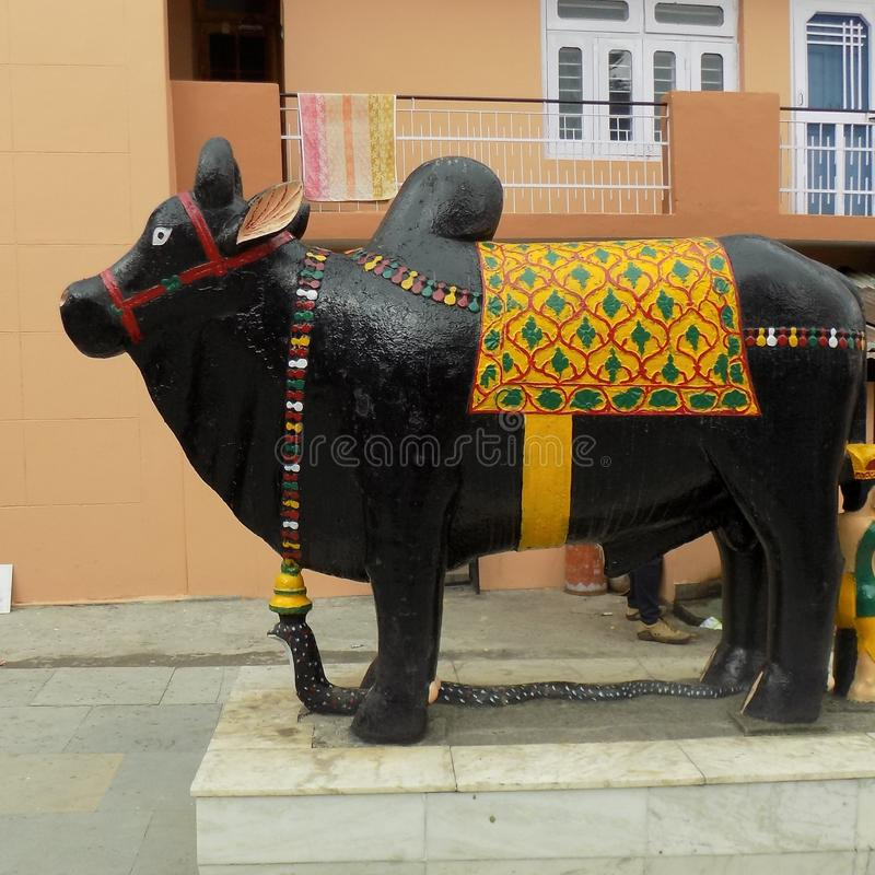 The Ox God Hindu Religious story about lord Shiva& x27;s devote. The Black ox made of black rock nandi maharajah stock photos