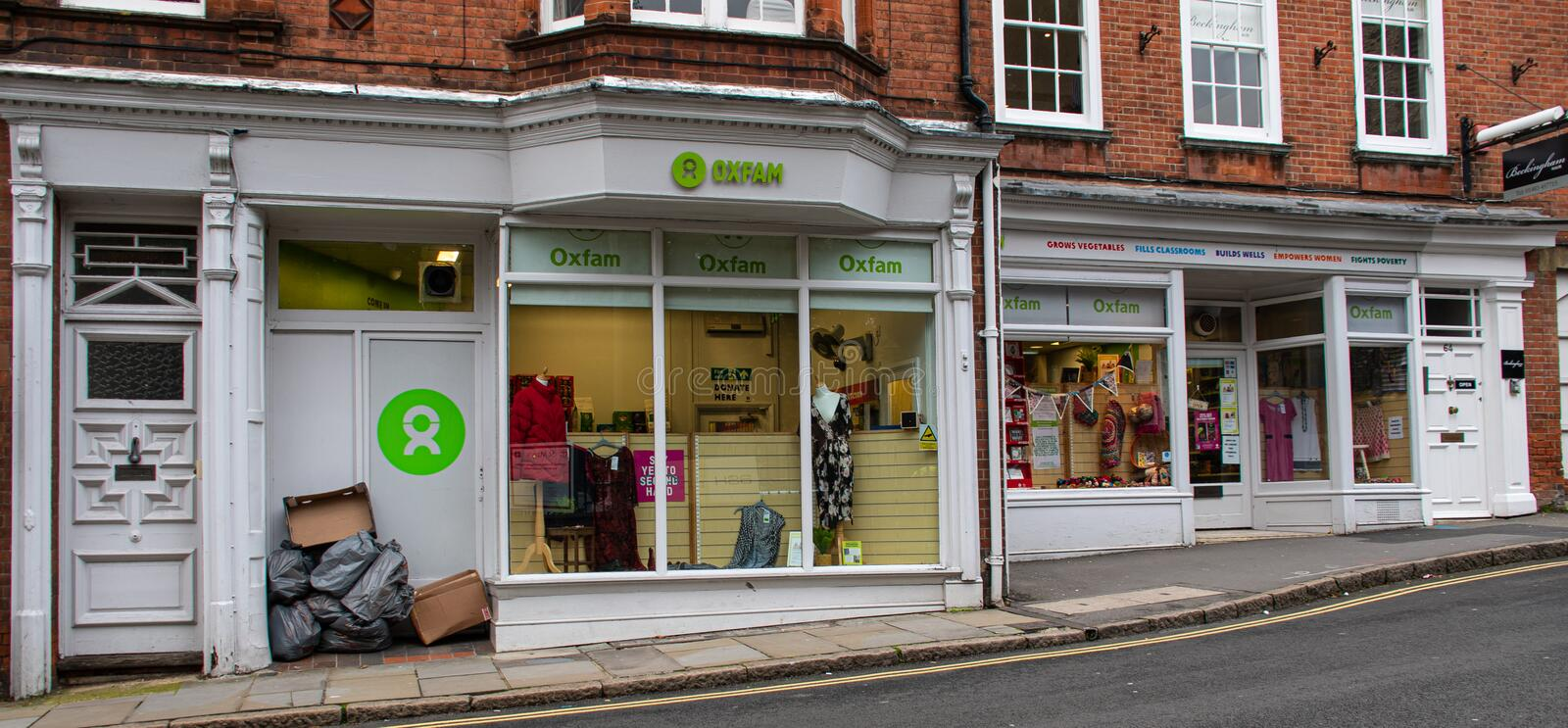 Oxfam shop Guildford. Guildford, United Kingdom - November 06 2019:   The entrance to the Oxfam charity shop on Millbrook stock photos