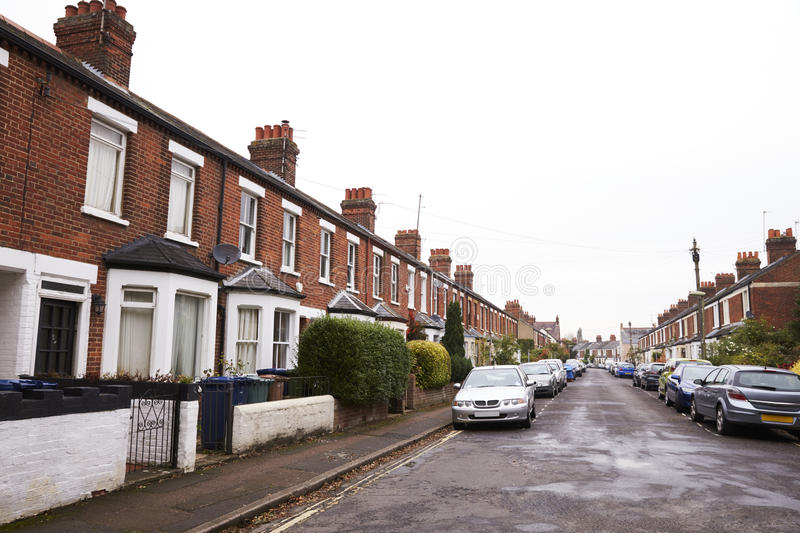 OXFORD/ UK- OCTOBER 26 2016: Exterior Of Victorian Terraced Houses In Oxford With Parked Cars stock photos