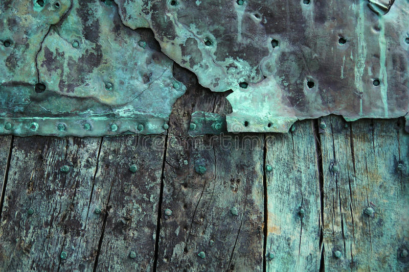 Oxidized copper. And decayed wood background royalty free stock photos